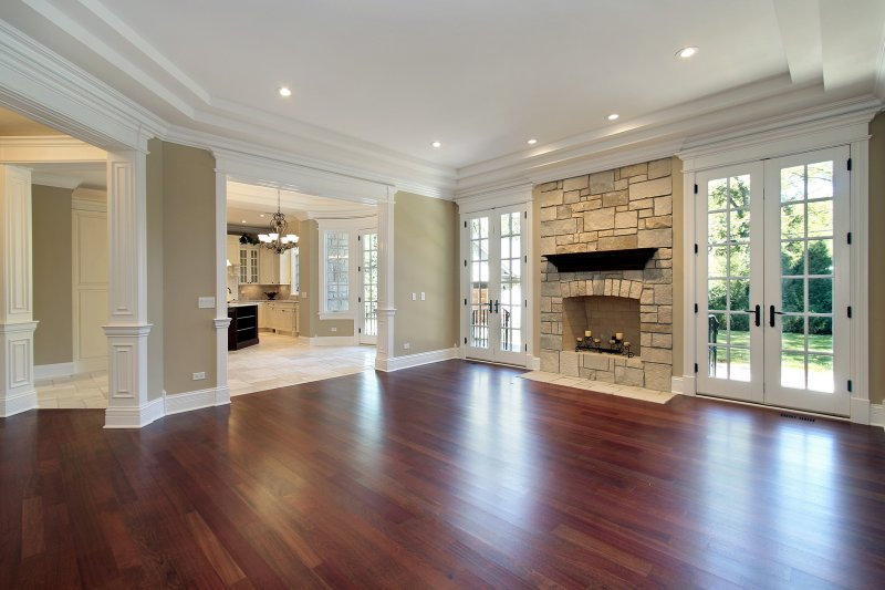 a large open living room with wood flooring