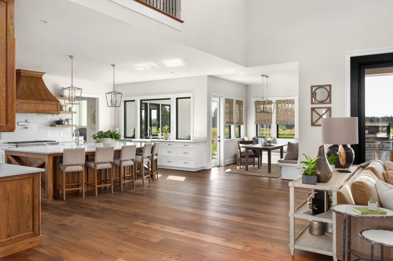 hardwood floors located in an open area space between the kitchen and living room