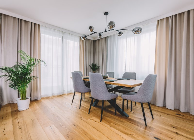 an image of a dining room table and chairs on top of hardwood floors
