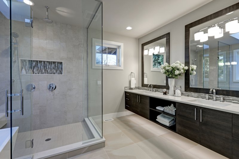 a large master bathroom, complete with tile floors