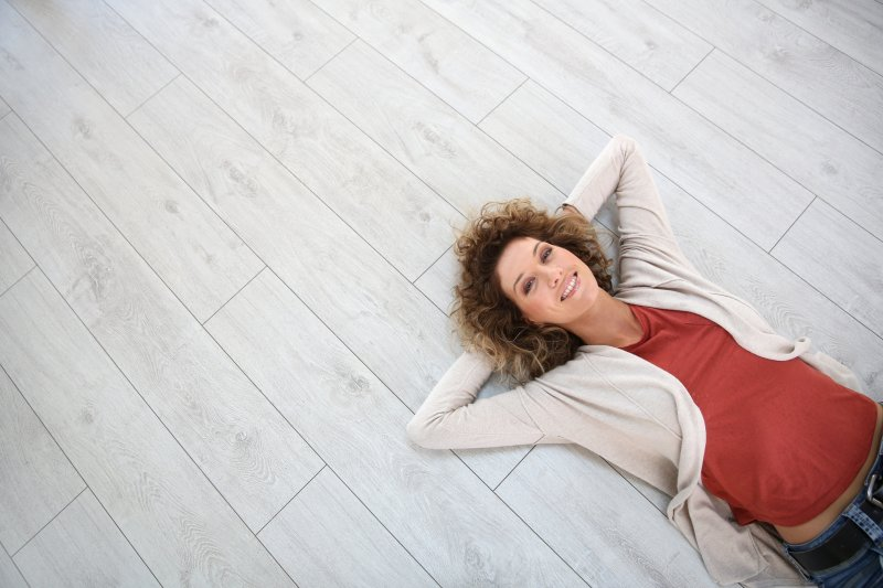 a woman laying comfortably on her floors
