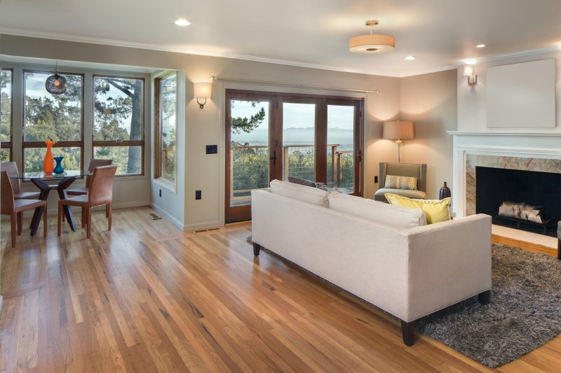 a nicely decorated living room with what appear to be wood floors