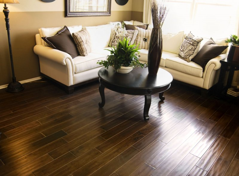 an image of a living room with refinished hardwood flooring in Keller
