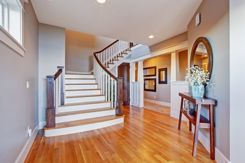 an entryway with light hardwood floors