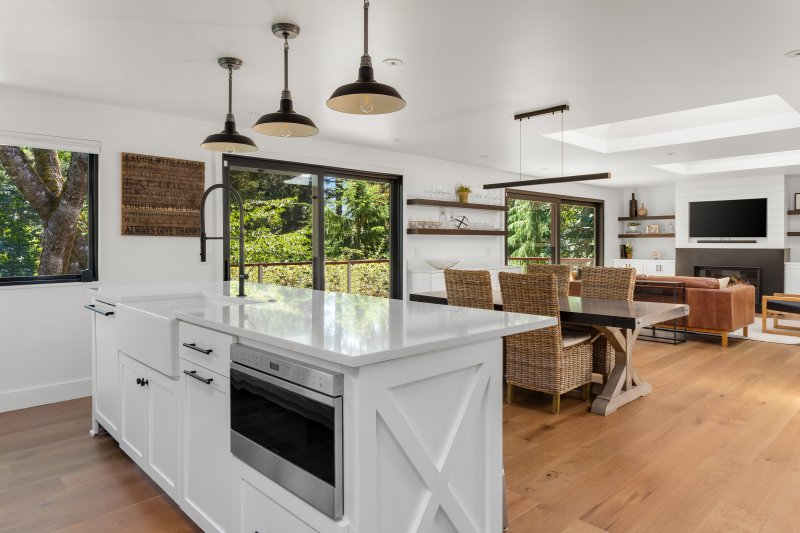 an open concept house with wood flooring
